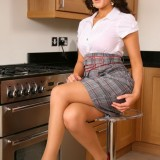 Kelly M Poses As A Secretary And Strips Down To Just Her Underwear