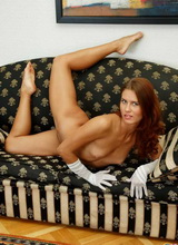 Naked redhead spreads exposing her beautiful flexible body