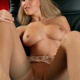 Busty Blonde Cikita Poses In Her Heels And Stockings