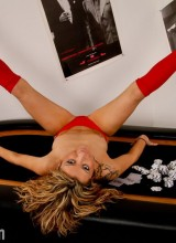 Noel on the poker table wearing red stockings with her trusty magic wand