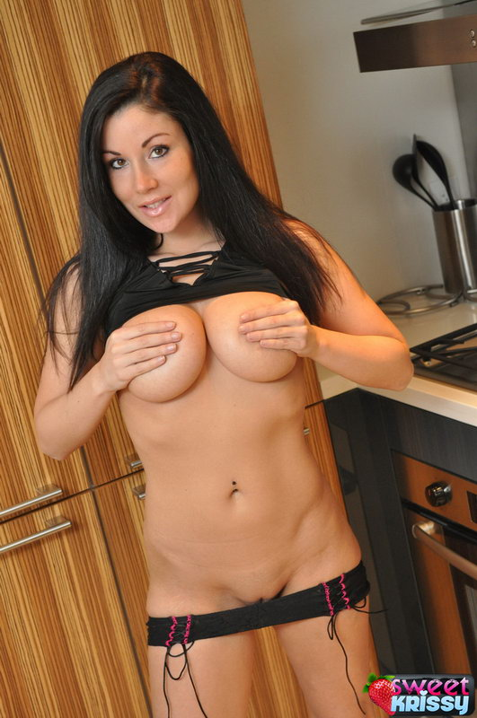 Krissy's Huge Boobs Are Almost Popping Out Of Her Top In The Kitchen
