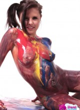 Sexy teen Dani Scott gets her hot body and tight pussy messy with paint