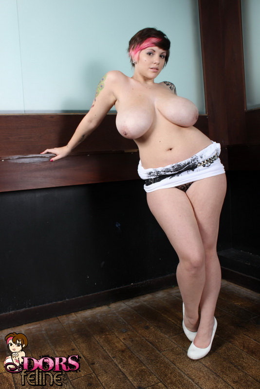 Dors Feline Strips Out Of Her Dress In The Club And Plays With Her Tits And Pussy
