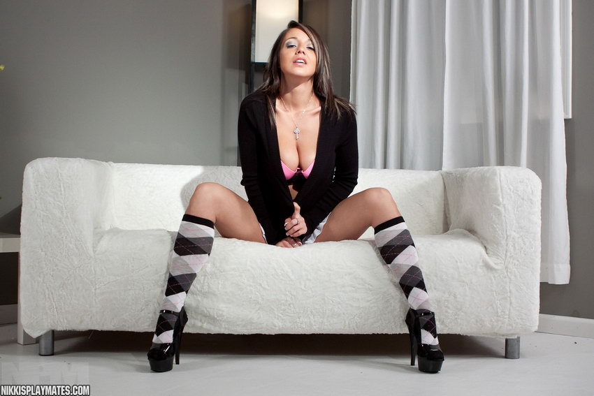 Nikki Sims In Skirt And Socks With Her Legs Spread On The Couch