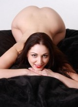 Radiant Desire: Carlotta Champagne naked and in the love sac showing off her curvy body