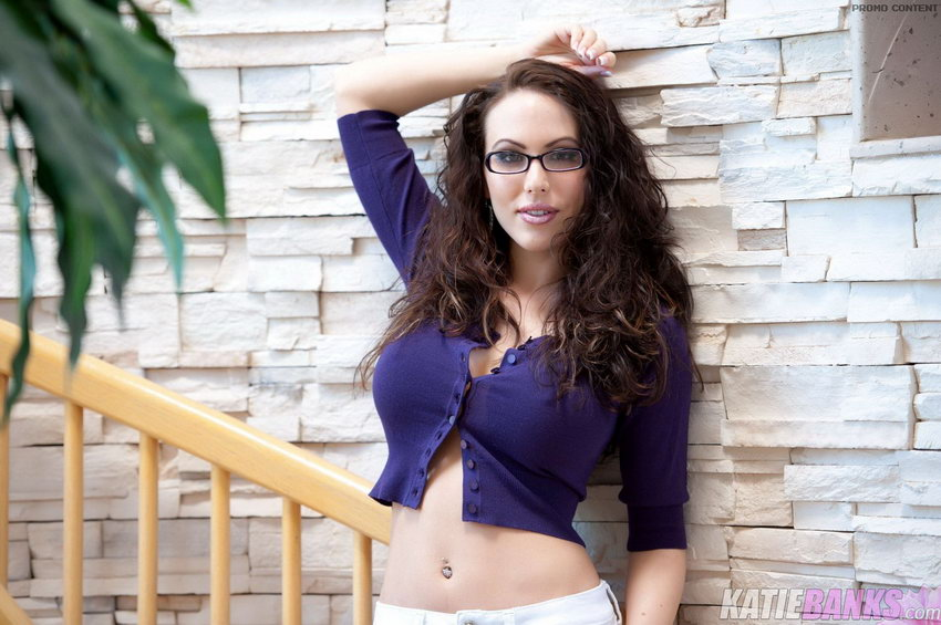 Katie Banks In A Purple Sweater On The Stairs
