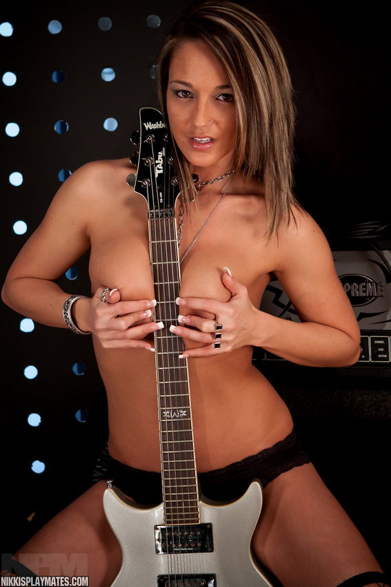 Busty Nikki Sims Is Ready To Rock Out With Her Boobs Out