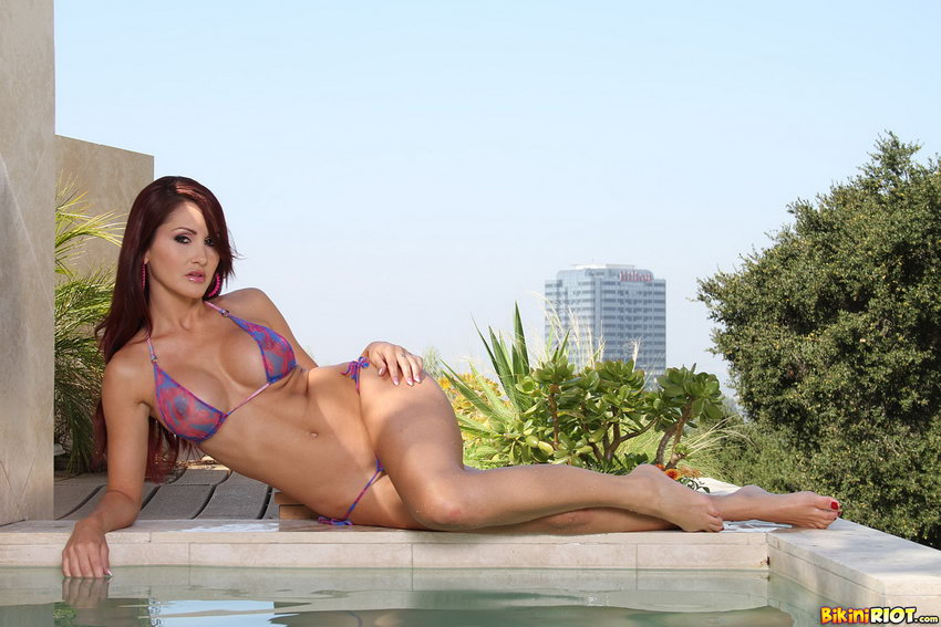 Bikini Riot: Evelin Rain Shows Off Luscious Hard Body In Sheer Gstring Bikini
