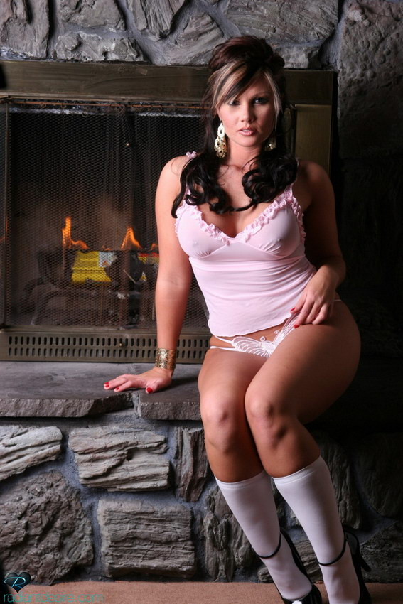 Radiant Desire: Leah Showing Off Her Curves In Front Of The Fireplace