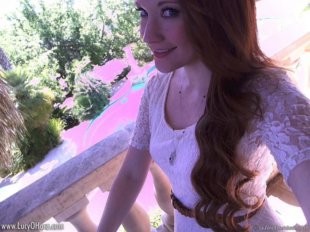 Lucy Ohara Wears No Panties Under Her Dress As She Spreads It On A Balcony