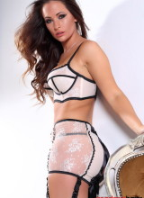 Anastasia Harris strips from her white and black trim lingerie
