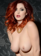 Lucy Vixen teasing us in her black top and lingerie