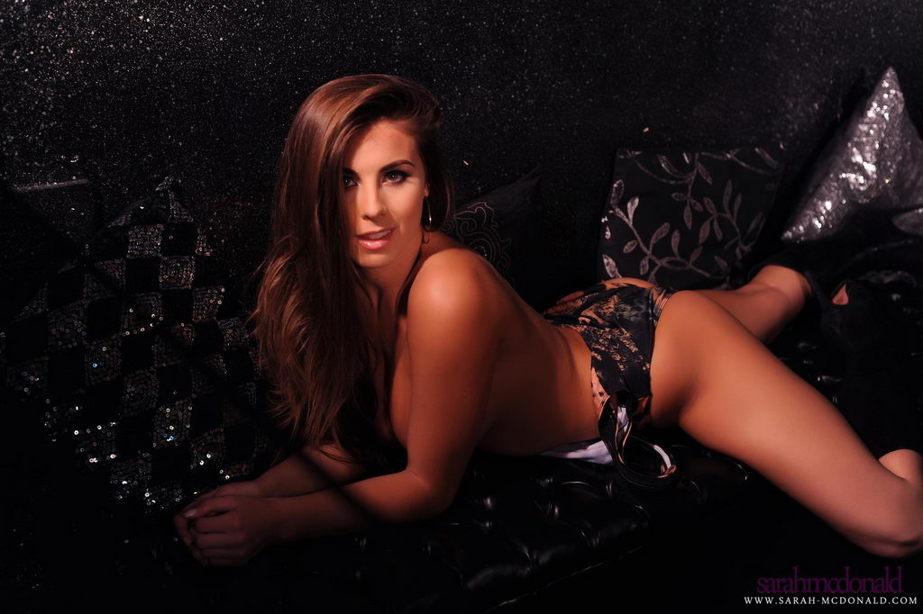 Sarah Mcdonald Teases In Her Leopard Body Suit On The Black Sofa