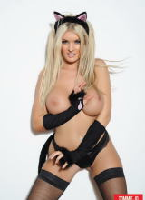 Tommie Jo teases in her black lingerie and stockings
