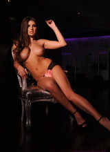 Sarah McDonald teases in her black and pink lingerie on the chair