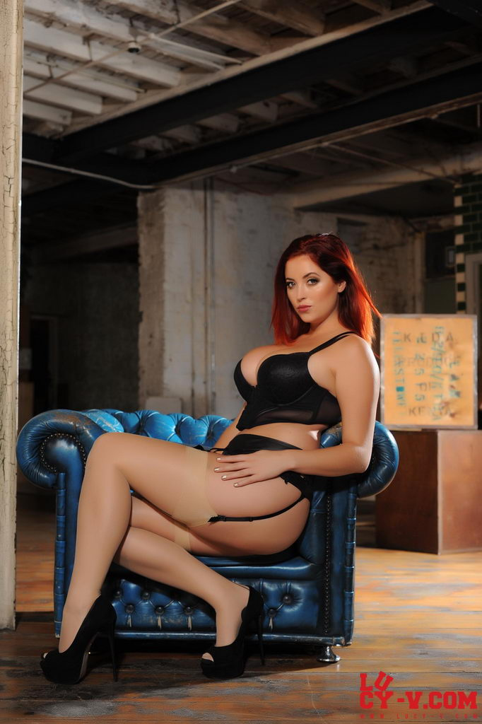 Lucy V Seduces Us On The Blue Chair, In Her Black Bodysuit And Stockings