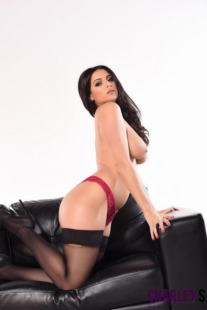 Charlotte Springer Teasing In Her Red Lingerie And Black Stockings.