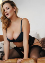 Jodie Gasson teasing in her dark blue lingerie and black stockings