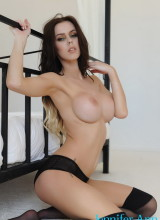 Jennifer Ann teasing in her tight black dress and lingerie in the bedroom