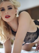 Jess Davies teasing on the bed in black lingerie and stockings