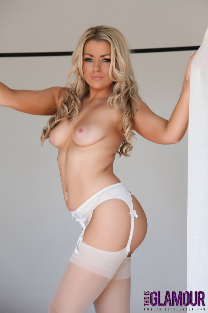 this is glamour: brandy brewer teasing on the bed in white lingerie