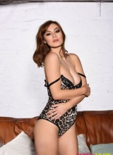 Summer St Claire teasing on the sofa in her leopard print bodysuit