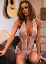 Jennifer Ann teasing on the sofa in her white lace see through lingerie