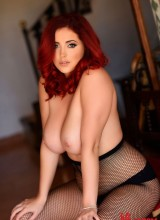 Lucy V teasing in black lingerie and fishnet pantyhose