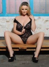 Jodie Gasson teasing in her black lace bodysuit