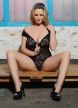 Jodie Gasson teasing in her black lace bodysuit