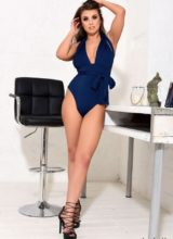 Sarah McDonald in sexy blue bodysuit