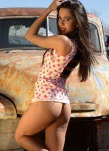 Bella Quinn strips in the junkyard